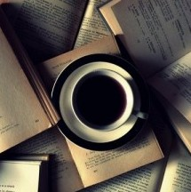 coffee on a pile of books